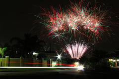 Fireworks Display With Car Driving Past. A long exposure photo of a fireworks display, celebrating the holiday of Diwali. The lights of a car driving past in the royalty free stock image