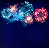Fireworks Display on Dark Blue Sky. Fireworks colorful display exploding on dark blue night sky Stock Image