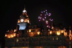 Fireworks display beside elegant hotel Royalty Free Stock Photos