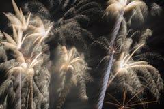Fireworks display. Golden fireworks against black sky Stock Photo