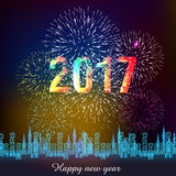 Fireworks display for happy new year 2017 above the city with clock Stock Photos