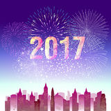 Fireworks display for happy new year 2017 above the city Stock Photos