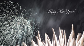 A fireworks display. With Happy New Year message Royalty Free Stock Image