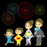 Fireworks display in Japan. Family in yukata, kimono for summer Stock Photos