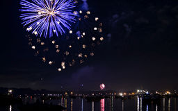 Fireworks display with lake reflection Stock Photos