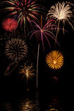 Fireworks display with lake reflections Stock Photos