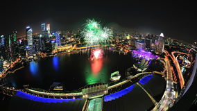 Fireworks display at Marina Bay during NDP 2012. Aerial view of fireworks display with Marina Bay city scape during National Day Parade 2012 Preview on August 04 Royalty Free Stock Photos