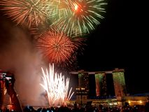 Fireworks Display & MBS. Beautiful display of fireworks in front of Marina Bay Sands Casino (MBS&#x29 Royalty Free Stock Photo