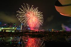 Fireworks display during National Day Parade (NDP) Preview 2014. SINGAPORE - AUGUST 02: Fireworks display during National Day Parade (NDP) Preview 2014 on August Stock Photography