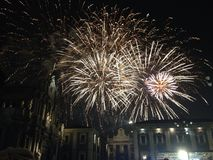 Fireworks display at night. Over buildings in the city of Catania, Italy stock photography