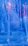 Fireworks. Display into the night sky royalty free stock photography