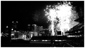 Fireworks Display @ PNC Park. Post game fireworks show held at PNC Park with the panorama of the city of Pittsburgh in the background.  PNC Park plays home to royalty free stock image