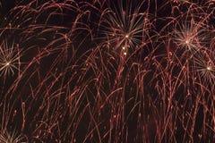 Fireworks display. Fireworks - a shower of red lights against black sky Stock Photos