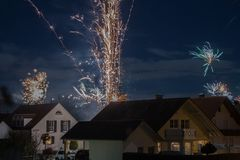 Fireworks display in small rural town. In Germany for New Year`s Eve Stock Images