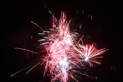 Fireworks display lights up the night sky royalty free stock photo