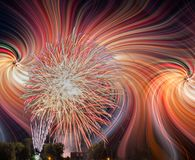 Fireworks Display and twirl effect. Colorfull fireworks display on the night sky with twirl effect royalty free stock photo