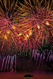 Fireworks display with yellow and pink sky over Geneva Royalty Free Stock Photos