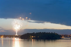 Fireworks at Dusk over Gull Lake Royalty Free Stock Photography