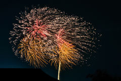 Fireworks explode over house roof Royalty Free Stock Photography