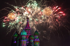 Fireworks explode over St. Basil Cathedral Stock Images