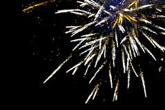 Fireworks explode in the sky on a black. Background royalty free stock photography