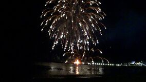 Pyrotechnics display over the beach at night. Bay.