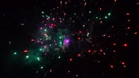 Fireworks exploding in the dark night sky stock video footage