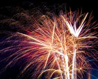 Fireworks exploding on a dark sky/ Fireworks on black background Royalty Free Stock Image