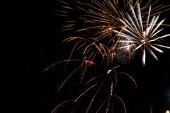 Fireworks exploding on a dark sky/ Fireworks on black background Stock Images