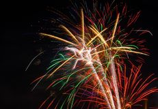 Fireworks exploding on a dark sky/ Fireworks on black background Stock Photography