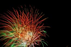 Fireworks exploding on a dark sky/ Fireworks on black background Royalty Free Stock Photos