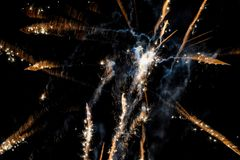 Fireworks exploding in the dark sky. Fireworks shooting in every diection and exploding on Guy Fawkes night Stock Image