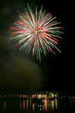 Fireworks exploding at night. Over harbour, Chinese New Year celebrations Royalty Free Stock Photo
