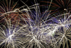 Fireworks exploding at night Stock Photo
