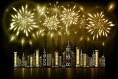 Fireworks exploding in night sky over downtown city with reflection in water of golden shdades Royalty Free Stock Photo