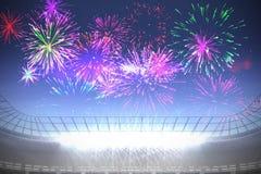 Fireworks exploding over football stadium Royalty Free Stock Photo