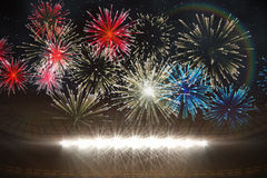 Fireworks exploding over football stadium. Digitally generated fireworks exploding over football stadium Royalty Free Stock Photos
