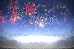 Fireworks exploding over football stadium Royalty Free Stock Photos