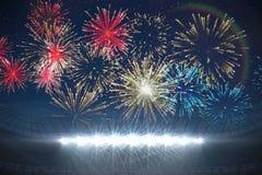 Fireworks exploding over football stadium Stock Photography