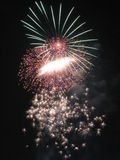 Fireworks exploding in sky. Three different types of fireworks exploding in the night sky royalty free stock photography