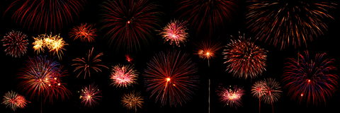 Fireworks exploding in sky. Panoramic view of red fireworks exploding in night sky Stock Photography