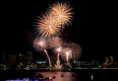 Fireworks explored over cityscape at night in sea port in Pattay royalty free stock image