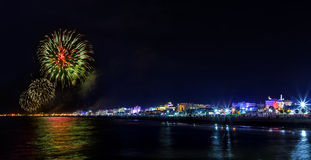 Fireworks explosion night show on seafront. Rimini