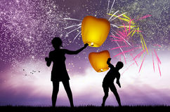 Fireworks explosion and sky lanterns Royalty Free Stock Photography