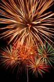 Fireworks explosions. Present firework on black background Royalty Free Stock Photos
