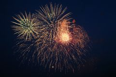 Fireworks explosions against the night sky.  stock photography
