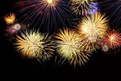 Fireworks explosions on black stock photos
