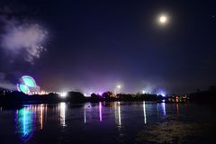 Fireworks and Fairground Rides at the Isle of Wight Festival 2018. Fireworks, lights and a near full `strawberry` moon reflect off the River Medina on the last Royalty Free Stock Photography