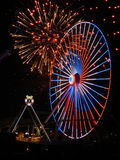 Fireworks and Ferris Wheel. Big ferris wheel with fireworks exploding in background Royalty Free Stock Photo