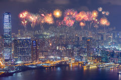 Fireworks Festival over Hong Kong city at night Stock Photos